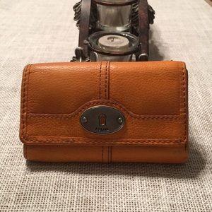 Orange Fossil bi-fold wallet.